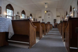 The church seats 125 guests in the orignal pews of long ago.
